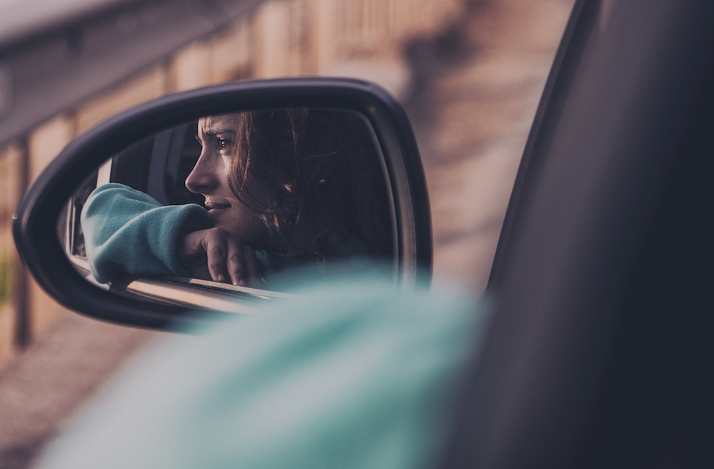 person reflected in rear view mirror2